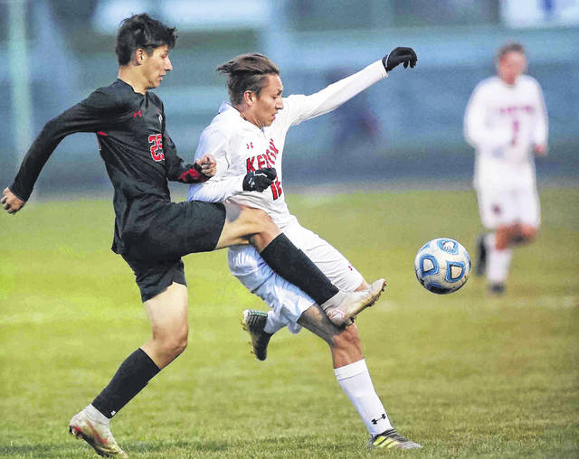Shawnee's Damien Zeigler, left, defends against Kenton's Jacob Zepeda during Thursday night's Division II district final at Elida. See more soccer photos at LimaScores.com.