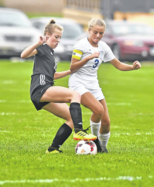 Spencerville's Raigan Staup, left, and Allen East's Ally Richardson battle for the ball during Tuesday night's match in Spencerville.