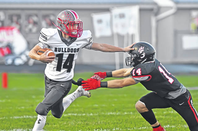 Columbus Grove's Trevor Taylor runs for yards against Spencerville's Cannan Johnson during Friday's game at Memorial Field in Spencerville. Taylor had a touchdown catch in the loss.