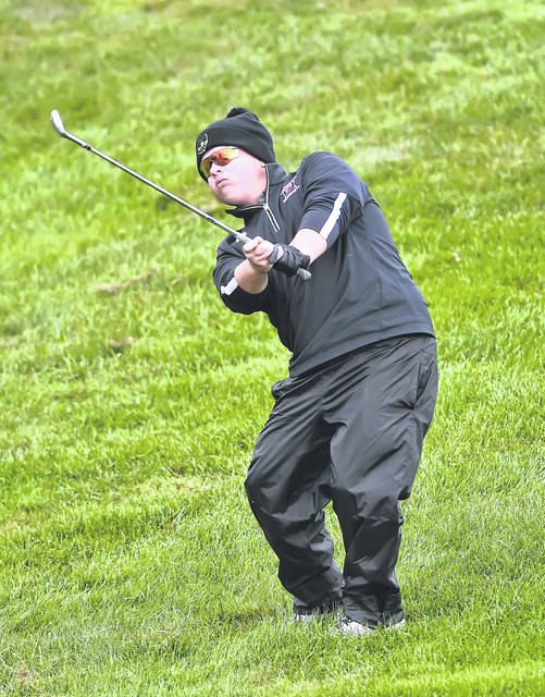 Spencerville's Gavin Harmon chips onto the 12th green during Saturday's boys Division III State Golf Championship at NorthStar Golf Club in Sunbury.