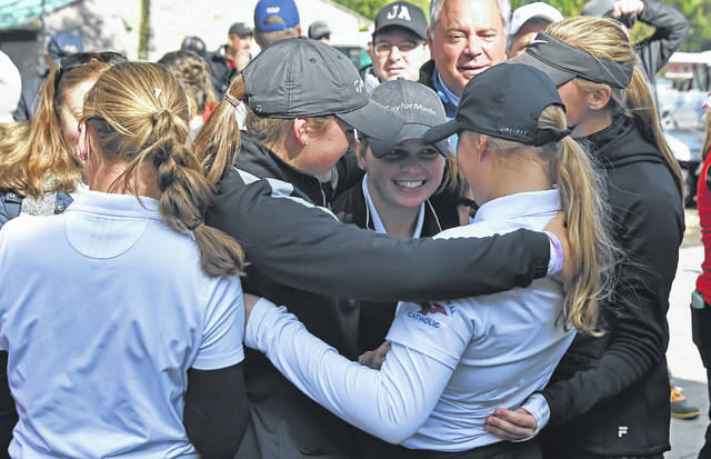 Lima Central Catholic's players celebrate winning the girls Division II State Golf Championship on Saturday at the Ohio State Golf Club in Columbus.