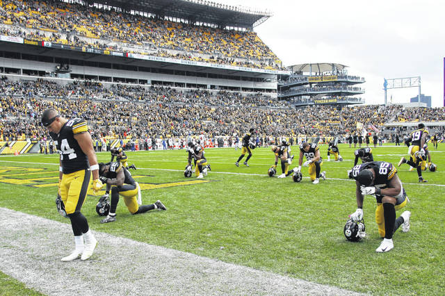 The Pittsburgh Steelers observe a moment of silence for the victims of a deadly shooting spree at a synagogue on Saturday before the start of an NFL football game against the Cleveland Browns, Sunday, Oct. 28, 2018, in Pittsburgh. (AP Photo/Gene J. Puskar)