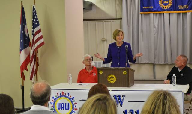 Betty Sutton (middle), Democratic candidate for lieutenant governor, criticizes DeWine's stance against an Obama-era overtime rule. She was joined by George Jeffries (left), co-chair of UAW Cap Council Lima-Troy, and Mike Copeland (right), president of UAW Local 1219.
