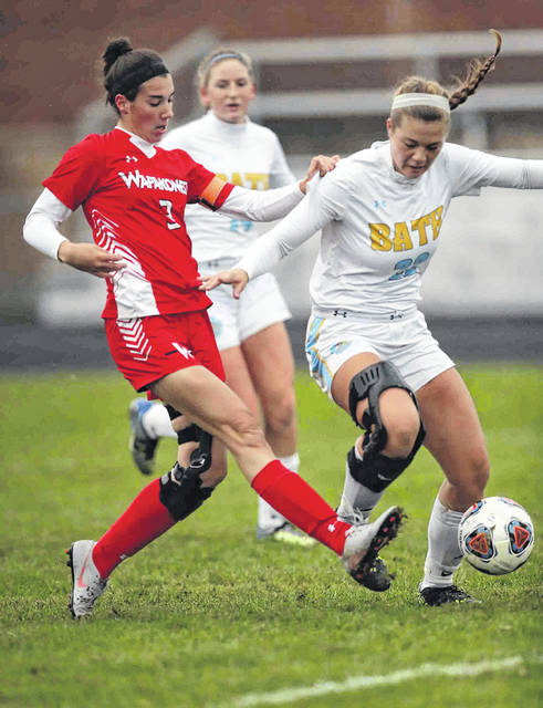 Wapakoneta's Abbigail Ruppert fires a shot on goal against Bath's Jordain Craig during Saturday's Division ll final at Elida.