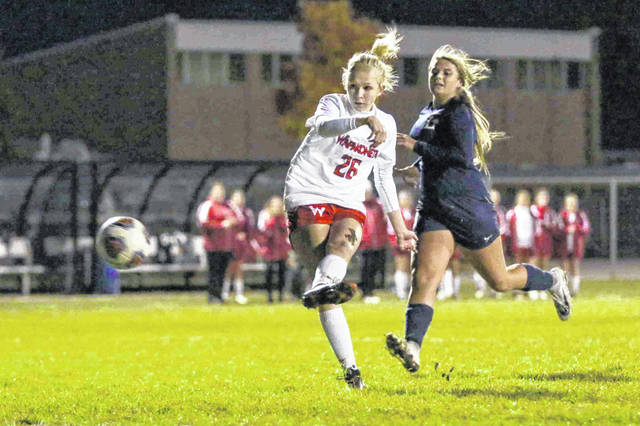 Wapakoneta's Morgan Follin slips passed Lake's Natalie Bomyea for a shot on goal to give the Redskins a 1-0 lead in the first half of the Division II Regional semifinal on Tuesday at Findlay High School.