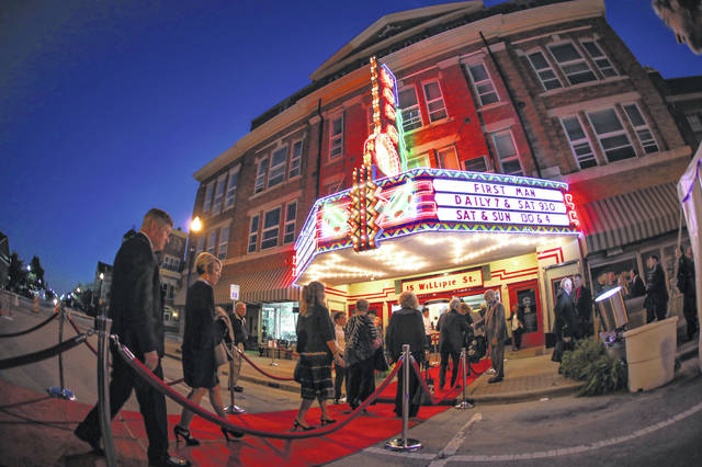 "Guests take the red carpet into the show during the gala and premiere of the movie ""First Moon"" at the Wapa Theatre in Wapakoneta Thursday evening. See Saturday's edition of The Lima News for complete coverage of the event, which celebrates Wapak native Neil Armstrong."