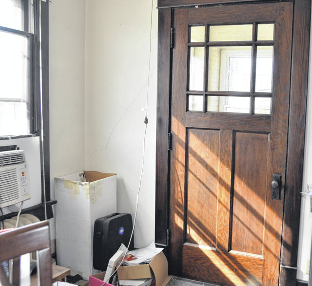 As Longmeier Printing and Advertising prepares to shut down the building on 232 N. Union St. Hartsock Realty Auctioneer Amy Joseph will be auctioning off an old door at 10 a.m. on Oct. 27.