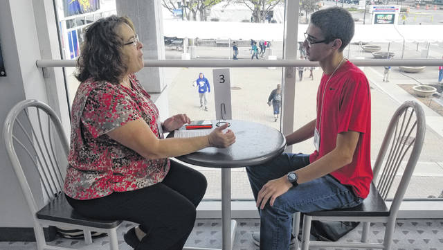 Beth Seibert, with Allen County Soil and Water Conservation District, conducts a mock interview with Van Wert High School senior Noah Carter during Makerfest Friday at Veterans Memorial Civic Center. See more photos of the event on 5A.