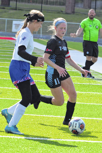 Crestview's Olivia Deasley chases Lima Central Catholic's Avery Rice during Saturday's Division III tournament match at Spartan Stadium.