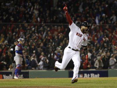 The Red Sox's Eduardo Nunez reacts after hitting a three-run home run Tuesday night during the seventh inning of Game 1 of the World Series against the Los Angeles Dodgers in Boston. (AP Photo)