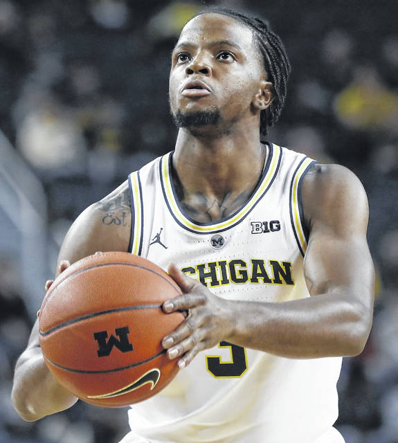 """Michigan's Xavier Simpson says """"people say I remind them of a pit bull so I'll take it."""""""