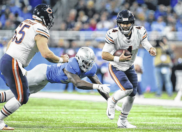 Chicago quarterback Chase Daniel (4) scrambles during Thursday's game against the Lions in Detroit.