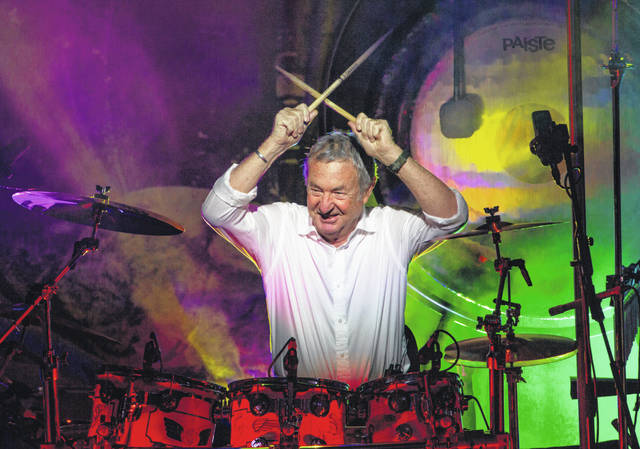 "Pink Floyd drummer Nick Mason performs with Nick Mason's Saucerful of Secrets band in Portsmouth, England, earlier this year. Mason plans to tour North America next year to perform some classic Floyd songs. His band will be jamming to pre-""Dark Side of the Moon"" material."