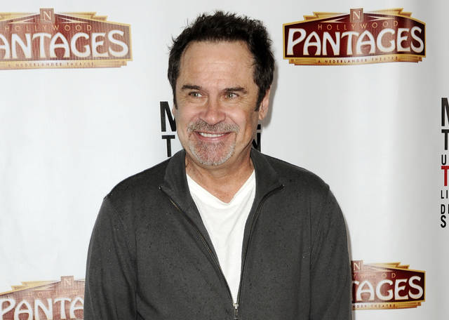"Comedian and former ""Saturday Night Live"" cast member Dennis Miller arrives at the premiere of ""Mike Tyson: Undisputed Truth"" in Los Angeles in 2013. Miller's new standup special, ""Fake News — Real Jokes,"" debuts online Tuesday."