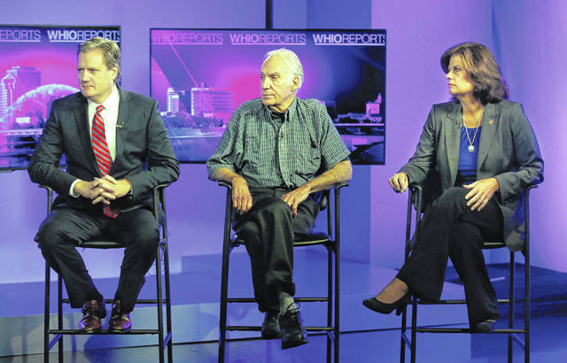 In this undated photo, Ohio's 10th Congressional District candidates from left to right are Republican incumbent Mike Turner, Libertarian Dave Harlow, and Democratic nominee Theresa Gasper appear on the WHIO Reports program in Dayton.