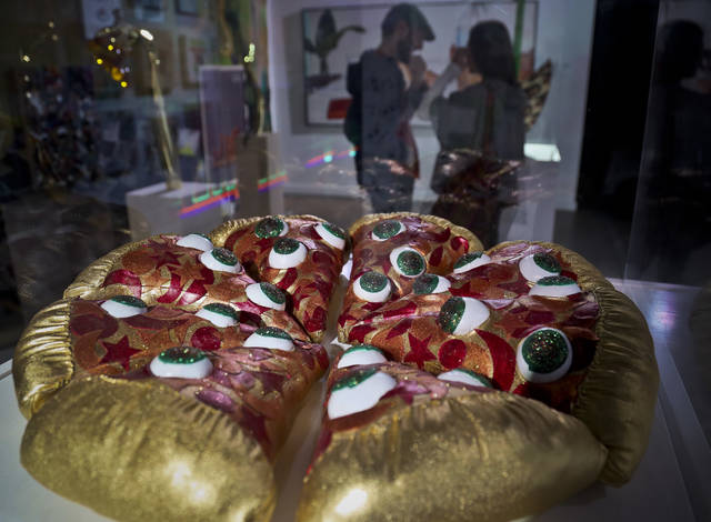"This Nov. 2, 2018 photo shows a textile sculpture from artist Hein Koh called ""Mystic Pizza,"" part of a group art exhibition celebrating pizza at The Museum of Pizza in New York. (AP Photo/Bebeto Matthews)"
