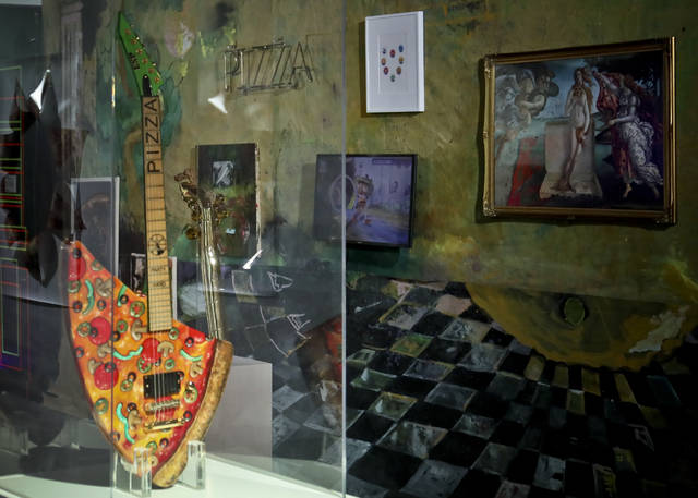 "This Nov. 2, 2018 photo shows the ""Pizza Guitar,"" from musician Andrew W.K., part of a group art exhibition celebrating pizza at The Museum of Pizza in New York. (AP Photo/Bebeto Matthews)"