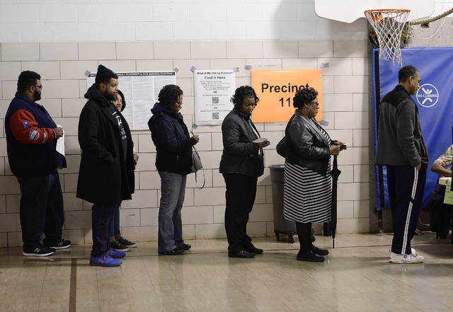 Voters wait in line to vote form for precinct 11 on election day, Tuesday, Nov. 6, 2018, Southfield,  Mich.   (Clarence Tabb, Jr /Detroit News via AP)