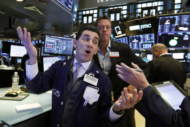 Specialist Peter Mazza, left, works on the floor of the New York Stock Exchange, Wednesday, Nov. 7, 2018. Stocks are climbing in early trading on Wall Street as results of the U.S. midterm elections came in as investors had expected. (AP Photo/Richard Drew)