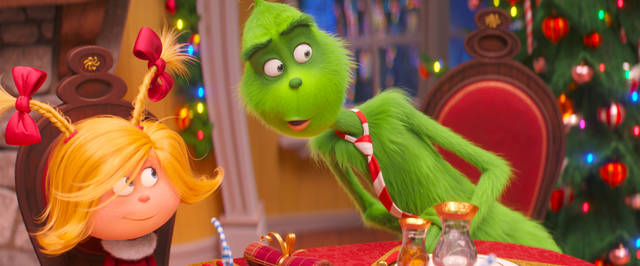 "FILE - This file image released by Universal Pictures shows the characters Cindy-Lou Who, voiced by Cameron Seely, left, and Grinch, voiced by Benedict Cumberbatch, in a scene from ""The Grinch."" ""Dr. Seuss' The Grinch"" made off with $66 million for Universal Pictures to top the weekend North American box office, according to studio estimates Sunday."