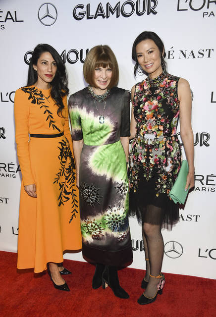 Political advisor Huma Abedin, left, Vogue editor-in-chief Anna Wintour and producer Wendi Deng Murdoch attend the Glamour Women of the Year Awards at Spring Studios on Monday in New York.