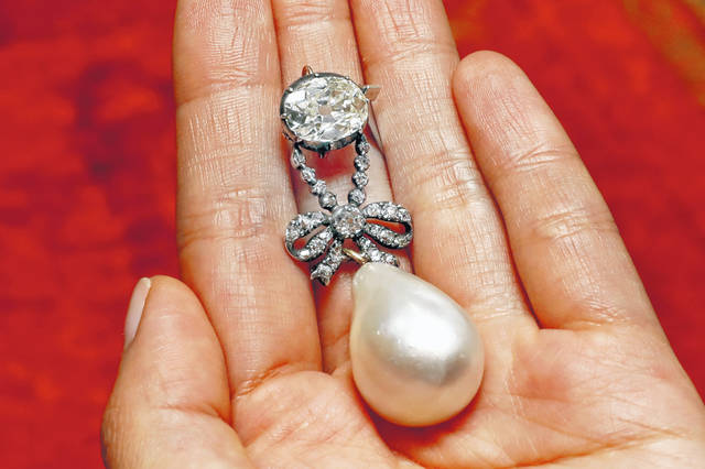 The Queen Marie Antoinette Pearl and diamond pendant, from the 18th century, is displayed at Sotheby's, in New York on Oct. 12. The large, drop-shaped natural pearl pendant sold for a hammer price of $32 million at an auction of jewelry that once belonged to French queen Marie Antoinette, which Sotheby's is calling a record price for a pearl at auction.