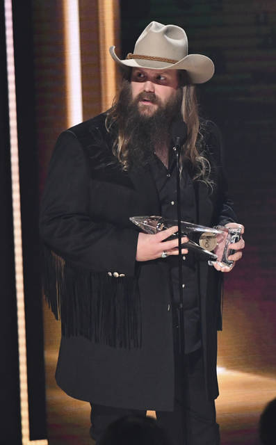 "Chris Stapleton accepts the award for single of the year for ""Broken Halos"" at the 52nd annual CMA Awards at Bridgestone Arena Nashville, Tenn., on Wednesday."