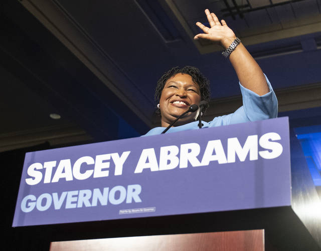FILE - In this Tuesday, Nov. 6, 2018 file photo, Georgia Democratic gubernatorial candidate Stacey Abrams speaks to supporters during an election night watch party in Atlanta. On Tuesday, The Associated Press has found that stories circulating on the internet that U.S. District Judge Leslie Abrams, sister of the gubernatorial hopeful, presided over a complaint related to the too-close-to-call governor's race, are untrue.