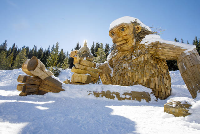"""The large wooden troll, """"Isak Hearthstone,"""" made by artist Thomas Dambo during Breckenridge International Festival of the Arts in August, sits in the snow Wednesday, Nov. 14, 2018, along the Wellington Trail in Breckenridge, Colo. The troll was created during the Breckenridge Festival of the Arts in August, but got so popular that it caused complaints from nearby homeowners due to tourists visiting, and demanded it to be removed.  (Hugh Carey/Summit Daily News via AP)"""