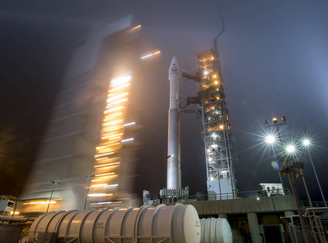 FILE - In this May 4, 2018 photo provided by NASA, the mobile service tower is rolled back to reveal the United Launch Alliance Atlas-V rocket with NASA's InSight spacecraft onboard at Vandenberg Air Force Base, Calif. NASA's three-legged, one-armed geologist known as InSight makes its grand entrance through the rose-tinted Martian skies on Monday, Nov. 26, 2018.  (Bill Ingalls/NASA via AP)