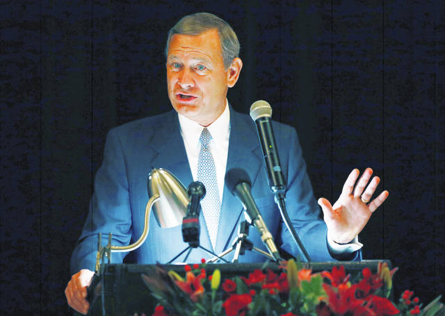 "Chief Justice John Roberts speaks in 2017 during the Bicentennial of Mississippi's Judiciary and Legal Profession Banquet in Jackson, Miss. Roberts is pushing back against President Donald Trump's description of a judge who ruled against the administration's new asylum policy as an ""Obama judge."""