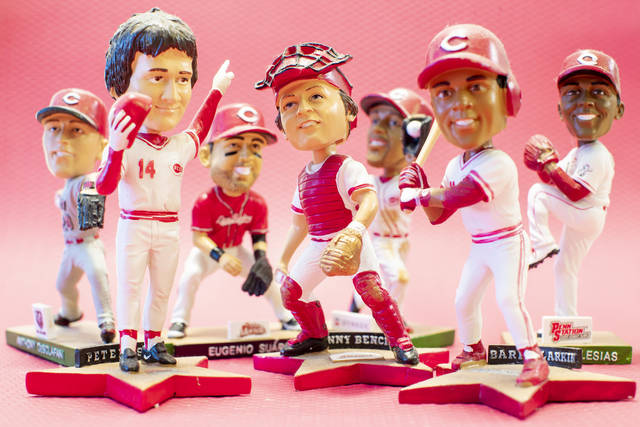 Cincinnati Reds bobbleheads are posed for display Wednesday in Cincinnati. The Ohio Supreme Court says the Reds are exempt from paying tax on the purchase of bobbleheads and other promotional items that the baseball team offers to ticket buyers.