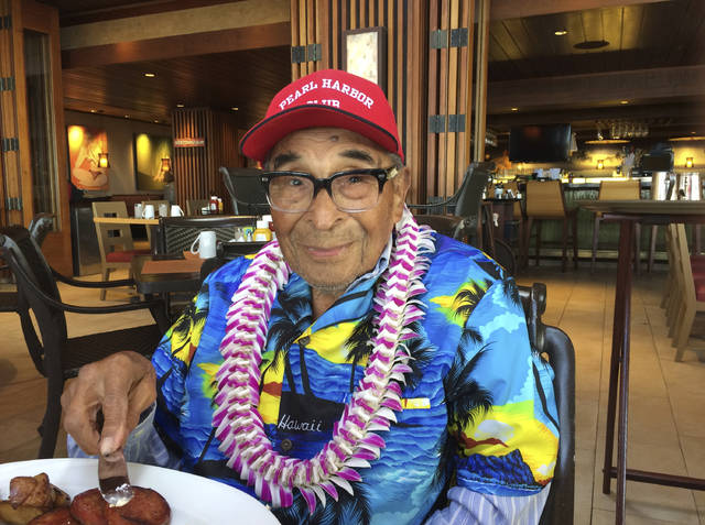 FILE - In this Dec. 5, 2016, file photo, Ray Chavez, a Pearl Harbor survivor from Poway, Calif., poses for a photo as he was eating breakfast in Honolulu. Chavez was out on a minesweeper, the USS Condor, in the early hours before the attack. The oldest U.S. military survivor of the Dec. 7, 1941, attack on Pearl Harbor has died at age 106. Chavez's daughter, Kathleen Chavez, of Poway, Calif., tells The Associated Press her father died in his sleep Wednesday, Nov. 21, 2018. (AP Photo/Audrey McAvoy, File)