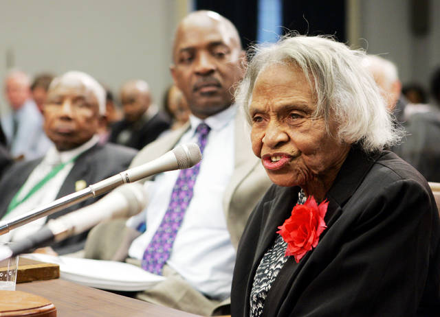 Dr. Olivia Hooker, a survivor of the 1921 Tulsa race riots, gives her personal account at a briefing before members of the Congressional Black Caucus and other leaders on Capitol Hill in Washington in May 2005. Hooker has died at age 103.
