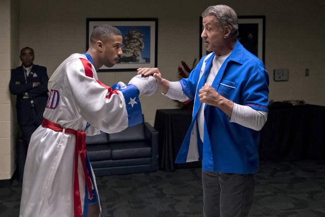 """FILE - This image released by Metro Goldwyn Mayer Pictures / Warner Bros. Pictures shows Michael B. Jordan, left, and Sylvester Stallone in a scene from """"Creed II."""" The Rocky spinoff """"Creed II"""" has placed second with $35.3 million from the weekend and $55.8 million since Wednesday, far surpassing the first film's Thanksgiving debut in 2015."""