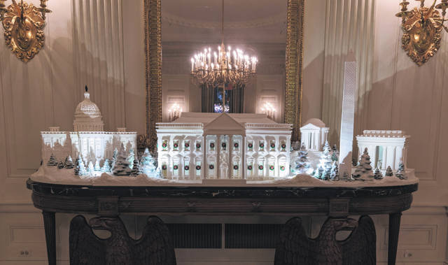 The gingerbread house, showcasing the full expanse of the National Mall — the Capitol, the Lincoln Memorial, the Jefferson Memorial, the Washington Monument and the White House — is seen in the State Dining Room during the 2018 Christmas Press Preview at the White House in Washington on Monday.