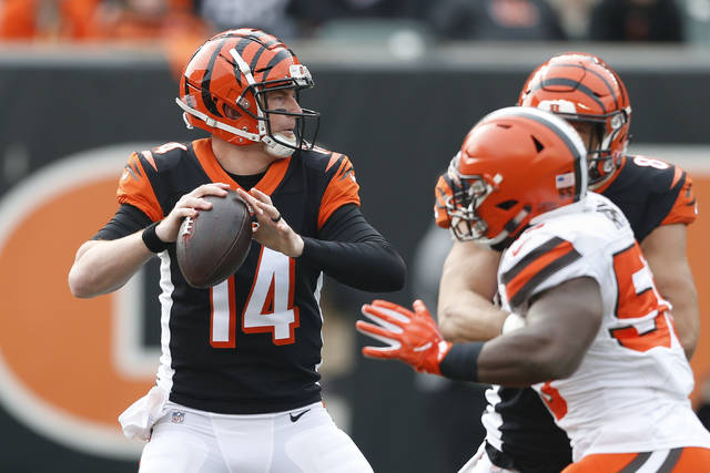 Cincinnati Bengals quarterback Andy Dalton (14) looks to pass in the first half of an NFL football game against the Cleveland Browns, Sunday, Nov. 25, 2018, in Cincinnati. (AP Photo/Gary Landers)