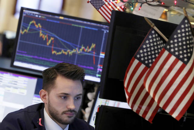 Specialist Matthew Greiner works at a post on the floor of the New York Stock Exchange, Monday, Nov. 26, 2018. Global markets are rising Monday as big technology stocks recover some of their recent losses and retailers and travel companies climb on the first full trading day of the holiday shopping season. (AP Photo/Richard Drew)