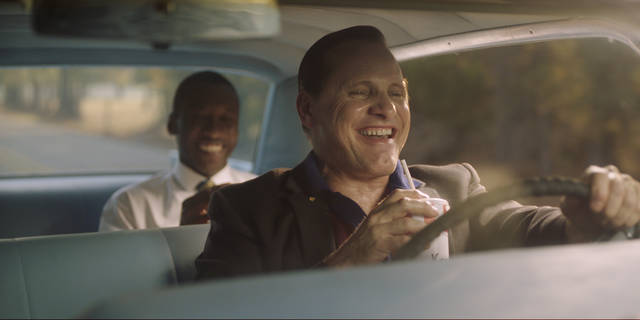 """This image released by Universal Pictures shows Viggo Mortensen, foreground, and Mahershala Ali in a scene from """"Green Book."""" The National Board of Review announced their 2018 honorees, Tuesday, Nov. 27, 2018, with top awards going to """"Green Book"""" as best film of the year and best actor of the year going to Mortensen. (Universal Pictures via AP)"""
