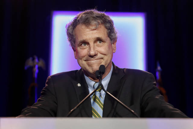 FILE - In this Nov. 6, 2018 file photo, Sen. Sherrod Brown, D-Ohio, reacts as he speaks to the audience during the Ohio Democratic Party election night watch party  in Columbus, Ohio. An all-Ohio presidential election in 2020? You would get very long odds in Vegas against that happening. It is possible, though, with two of the state's most popular politicians considering running. Republican Gov. John Kasich ran in 2016 and seems ready to try again in 2020.  Brown says he's seriously considering a run. (AP Photo/John Minchillo, File)