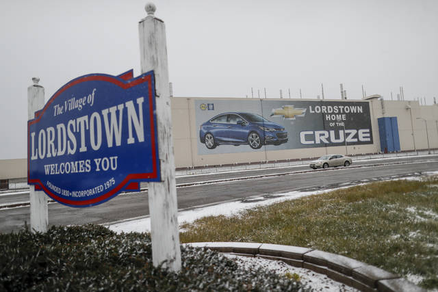 A banner depicting the Chevrolet Cruze model vehicle is displayed at the General Motors' Lordstown plant, Tuesday, Nov. 27, 2018, in Lordstown, Ohio. Even though unemployment is low, the economy is growing and U.S. auto sales are near historic highs, GM is cutting thousands of jobs in a major restructuring aimed at generating cash to spend on innovation. GM put five plants up for possible closure, including the plant in Lordstown. (AP Photo/John Minchillo)
