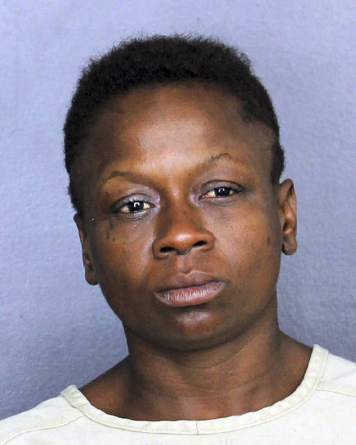 In this Nov. 25, 2018 photo, Shenetta Yvette Wilson is under arrest. Wilson faces an aggravated assault charge after authorities say she passed gas in line at a Dollar Store in Dania Beach, Fla., and pulled a knife on a man who complained about it. (Broward County Sheriff's Office via AP)