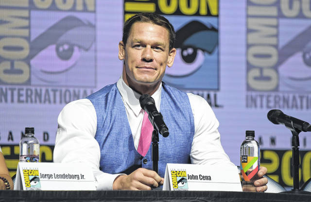 """John Cena attends the """"Bumblebee"""" panel on day two of Comic-Con International in San Diego in July. Cena, a WWE superstar, is the recipient of this year's Sports Illustrated Muhammad Ali Legacy Award. The award is given each year to an athlete or sports figure who embodies the ideals of sportsmanship, leadership and philanthropy while using sports as a platform."""