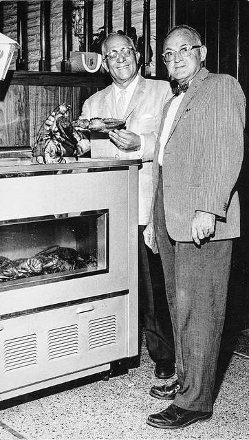 This 1963 photo shows a lobster tank at a restaurant.