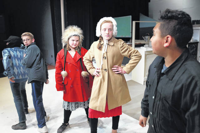 "Girls Josie Ricker and Jillian Hazelton, portraying Esther Jane Alberry and Helen Weathers, confront bully Scut Farkas played by Zac Campbell during the play ""A Christmas Story."" It opens tonight at Encore Theatre."