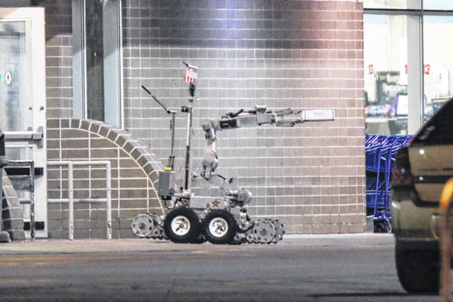 An Allen County Regional Bomb Squad robot exited the Lima Meijer Sunday with a package. Reports of a suspicious package led to the store and parking lot being evacuated.