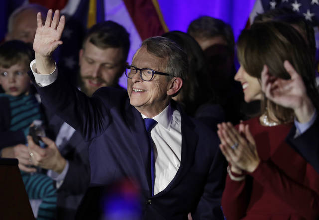 Governor-elect Mike DeWine waves to supporters after speaking at the Ohio Republican Party event, Tuesday, Nov. 6, 2018, in Columbus, Ohio. (AP Photo/Tony Dejak)