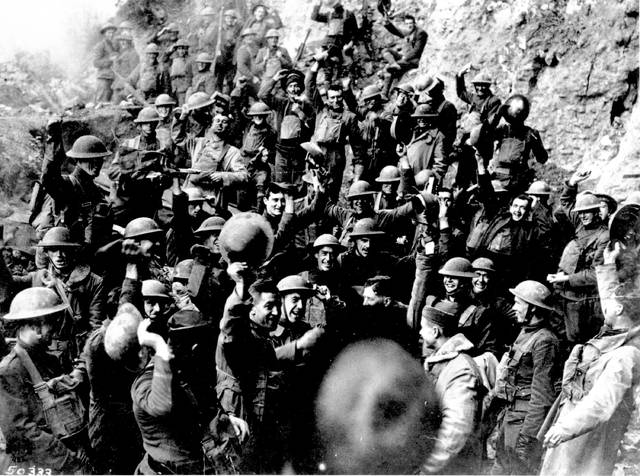 FILE - In this Nov. 11, 1918 file photo, American troops cheer after hearing the news that the Armistice had been signed, ending World War I.