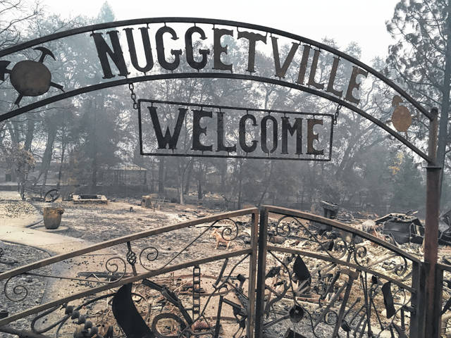 FILE - This Wednesday, Nov. 14, 2018 shows the remains of the Gold Nugget Museum, which was totally demolished by the Camp Fire, in Paradise, Calif. Paradise, Cali., literally went up in smoke in the deadliest, most destructive wildfire in California history. And memories are all that's left for many of the survivors. They recall a friendly place where the pace was relaxed, where families put down roots and visitors opted to stay.