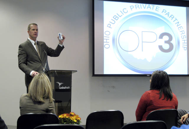 FILE - In this Oct. 7, 2014 file photo, Ohio Department of Public Safety Director John Born holds a can of water while speaking at the fall conference for the Ohio Public Private Partnership in Dublin, Ohio. After 31 years in law enforcement, Born has witnessed his share of crashes, crime and human misfortune. But it hasn't made him cynical. Ohio's retiring public safety director said the secret to his optimism is in the numbers. (AP Photo/Kantele Franko, File)